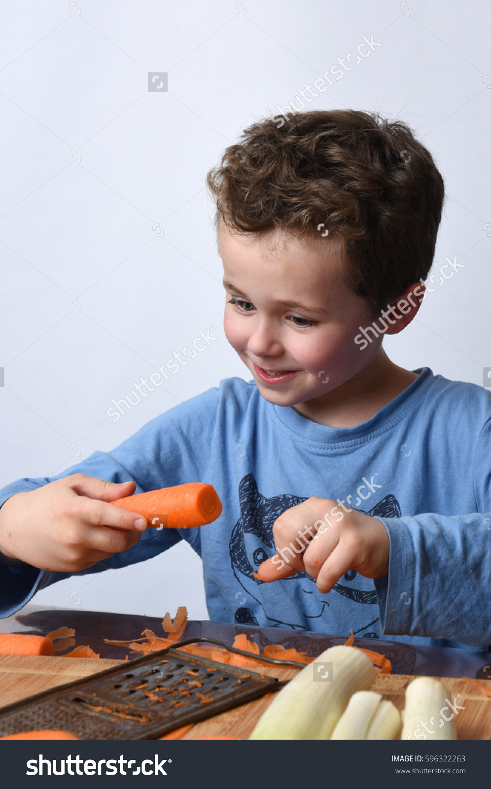 stock-photo-child-cooking-596322263