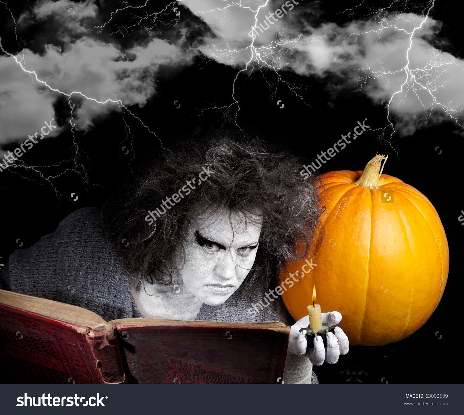 stock-photo-witch-with-a-magic-book-and-pumpkin-halloween-theme-63002599