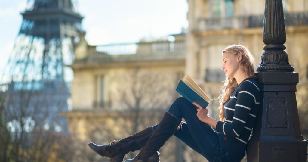 Beautiful-young-woman-in-Paris-reading-a-book