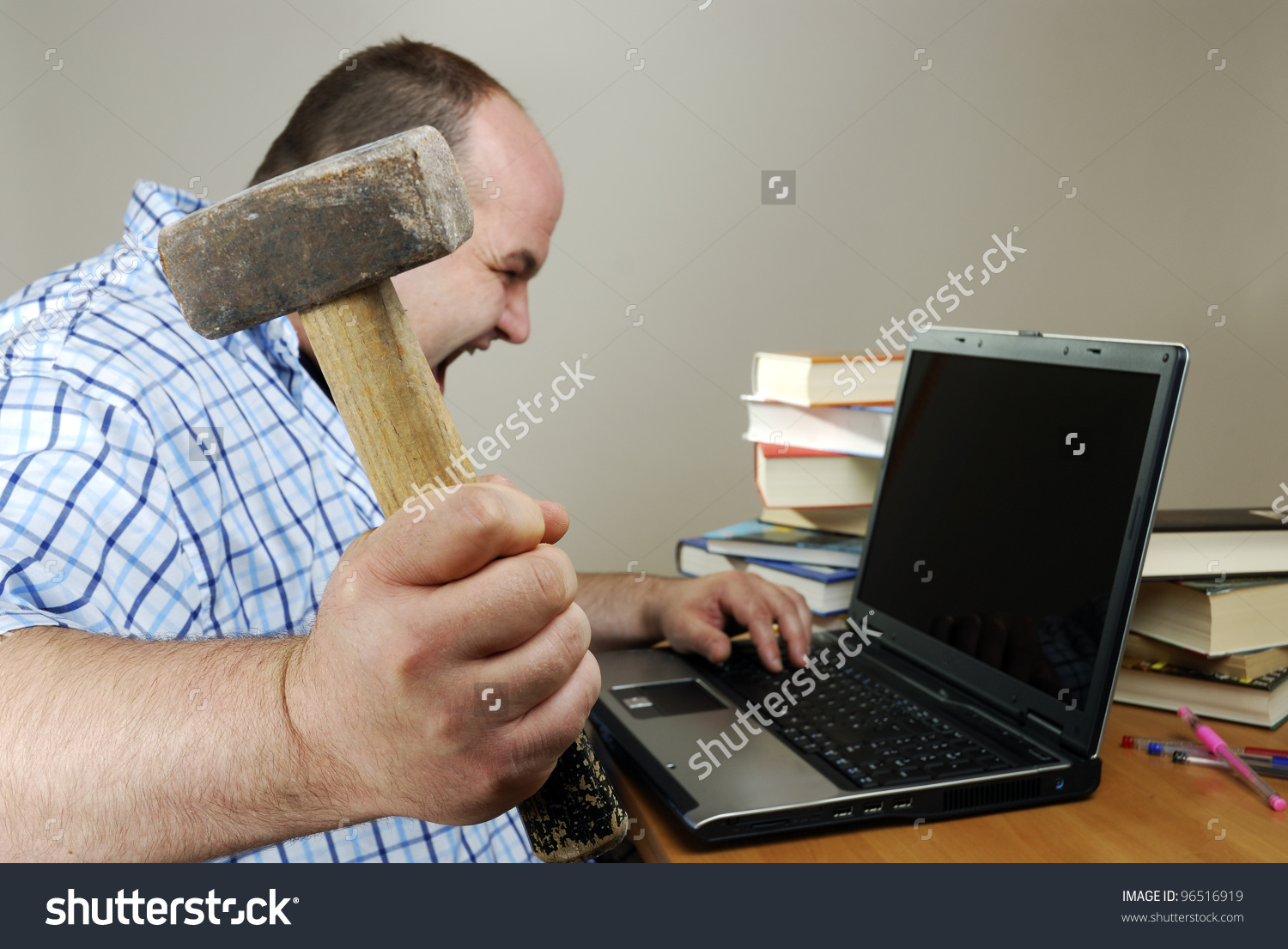 stock-photo-angry-man-is-about-to-smash-his-computer-96516919