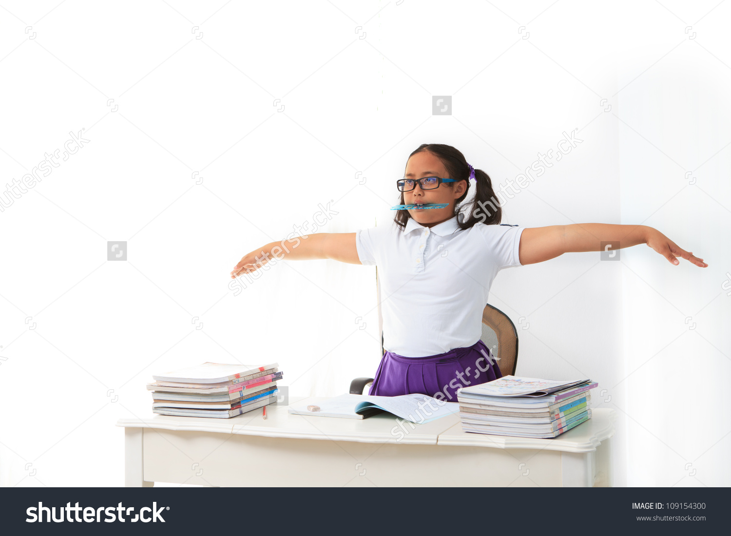 stock-photo-girl-standing-with-ruler-in-her-mouth-in-class-room-109154300