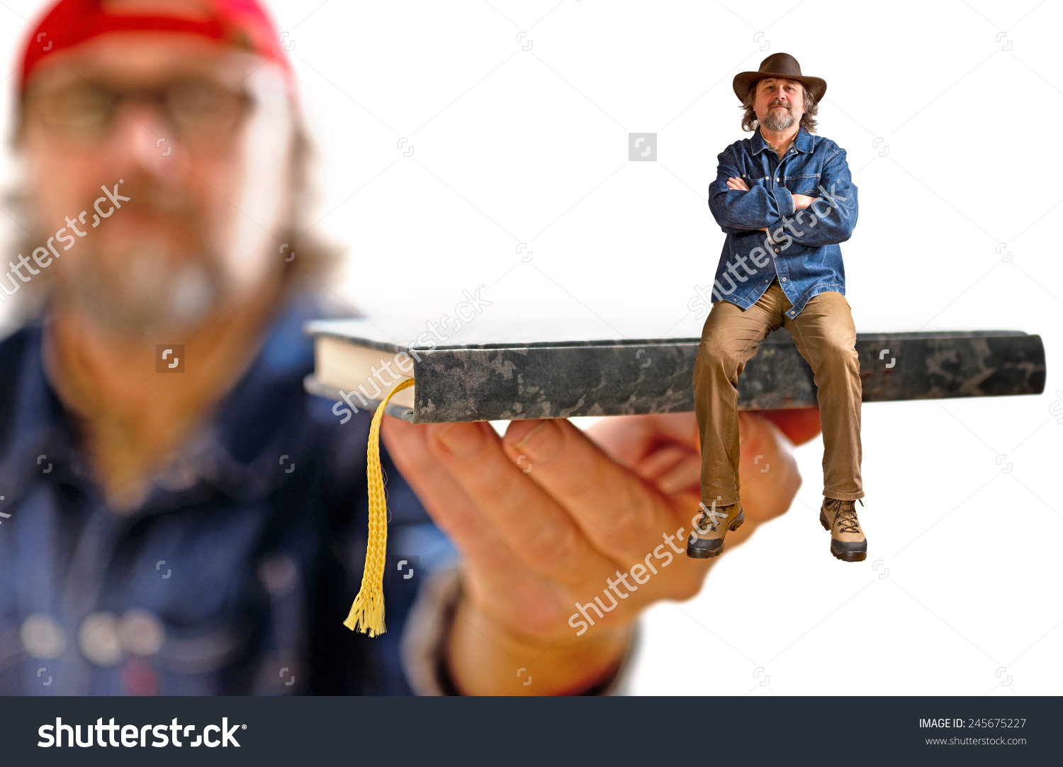stock-photo-man-with-hat-sitting-on-the-book-245675227