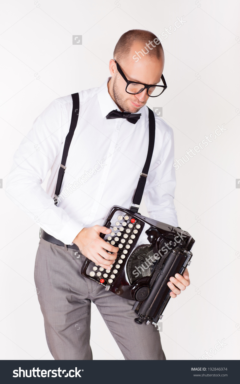 stock-photo-portrait-of-a-young-businessman-with-a-typewriter-192846974