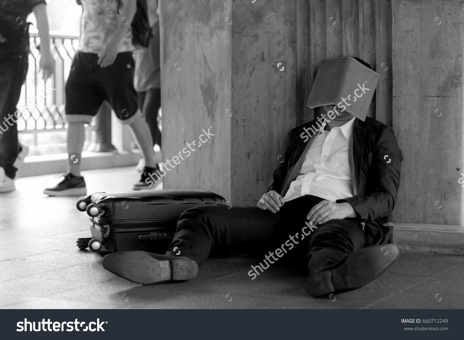 stock-photo-stressed-asian-businessman-bankrupt-with-sitting-at-outdoor-and-book-close-face-660712249