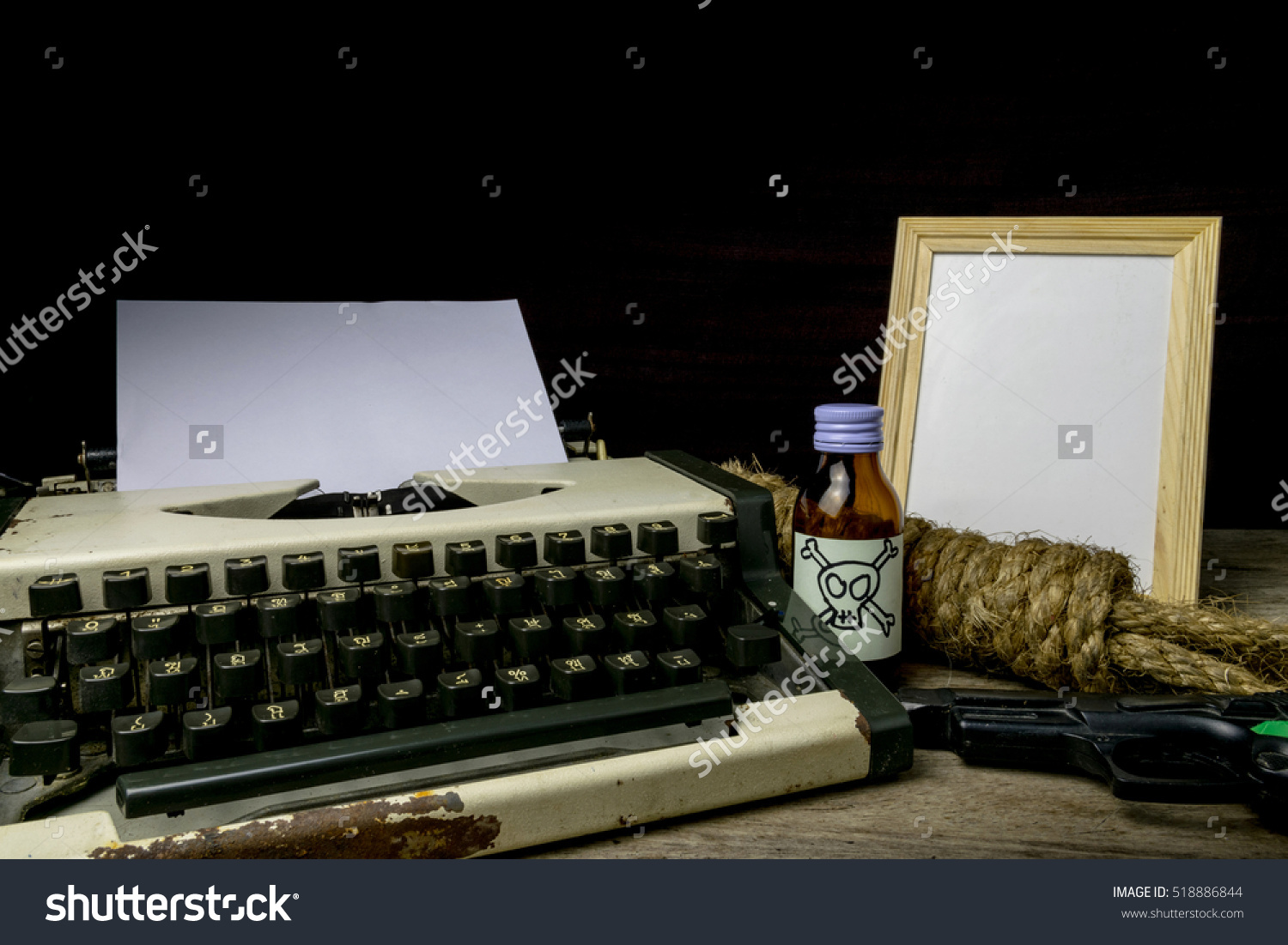 stock-photo-typewriter-with-paper-page-and-poison-and-gun-concept-writer-romance-suspense-518886844
