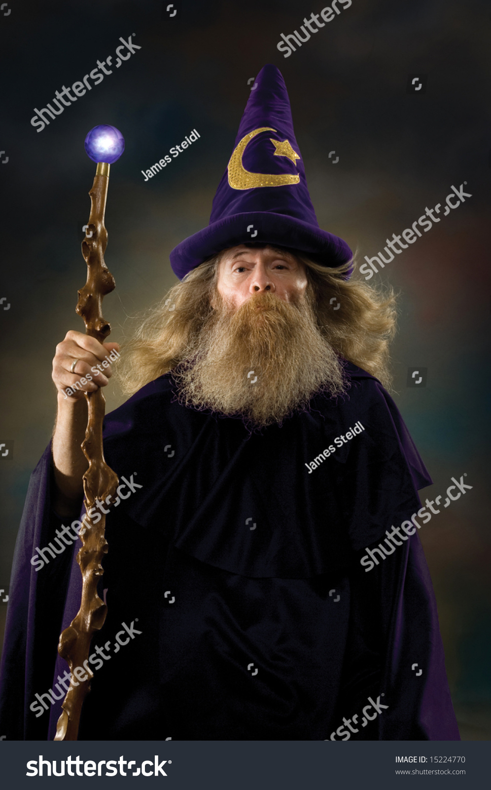 stock-photo-wizard-with-posing-for-a-portrait-15224770